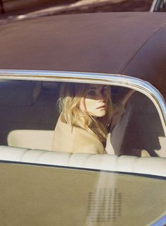 She finally built up the courage to up & leave that town. She looked back from the cabs' rear view window. Not so much because she was sad, but because she felt like a passenger traveling through town to her true destination...experiencing how travelers must feel.
