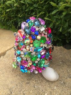 Wow! what a beauty! This little statement piece will dazzle all! created from Czech glass upcycled rhinestones of all different colours- she is