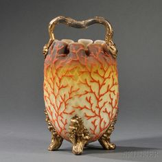 Coralene and Satin Glass Handled Vessel  Art glass  United States, late 19th century  Gilt twig-form handle, brown ruffled rim shading to yellow quilted satin glass body with coralene decoration, raised on four curled leaf-form gilt feet.