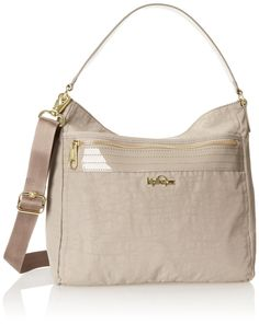 Kipling Sansa (One Size, Beige/Beige Patent Combo). Top zip closure, an interior zippered pocket. Exterior offers a front slip and zip pocket as well as a rear slip pocket for quick grab items. Convenient removable adjustable shoulder strap to carry over the shoulder or as a cute handbag. Made with polyester, faux patent accents and a textile polka-dot lining.