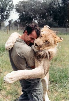 Kevin Richardson- lion whisperer...This guy is utterly amazing...His bond with these animals is unparalleled and I wish I were him!!!