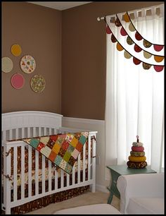 super cute woodland themed nursery. Love the fabric in the hoops and what a cute way to dress up a window <3