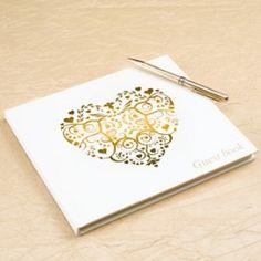 <p>Prachtig ivoorkleurig gastenboek met een gouden foliedruk van een gedecoreerd hart aan de voorkant. Rechts onderin staat  'Guestbook' geschreven.</p> <p>Dit boek bevat 35 blanco pagina's. Op de eerste pagina is het woord 'Guests' geprint met een lijn daaronder om de gelegenheid in te vullen. Afmetingen: 22 x 19 cm</p> <p>Een gastenboek is een must voor een bruiloft. Je ziet alle gasten even tijdens het feliciteren, anderen spreek je wat langer, maar om te weten wie er allemaal ...