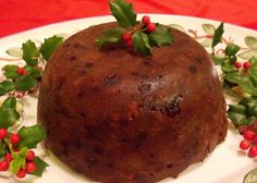 """Christmas Pudding: """"This is a traditional dessert, served on Christmas Day in most Irish and British households, and made four to six weeks before Christmas.  This practice originated in medieval England, when it was often referred to as plum pudding.  Old recipes call for a mixture of dried fruits and sweet spices, very luxurious ingredients in olden times."""""""