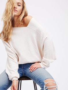 The Check Sweater   Comfortable sweater with a super stretchy fabrication. Structured and slightly off-the-shoulder neckline with drapey sleeves make it a cool, effortless look. Band at the waist.