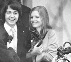 Paul and Linda (with their new kitten) on their wedding day.