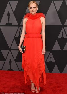 All eyes on her: Diane Kruger, 41, made quite the entrance in a standout red, halter dress...