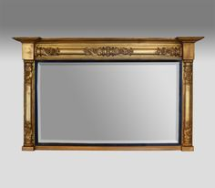 William IV gilt overmantel mirror. Moulded cornice over a turned baluster frame with decorative foliate carvings. The replacement bevelled plate glass set within a reeded ebony slip.  circa. 1835 £1,750
