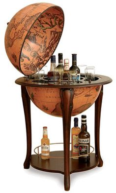 This is the coolest alcohol holder ever. This would be perfect for my old world inspired library. (all in my imaginary dream house of course.)