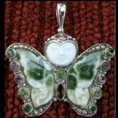 I just added this to my closet on Poshmark: STERLING SILVER Gemstone Buddha Butterfly PENDANT. Price: $150 Size: Large