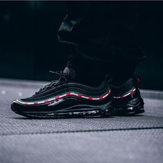 This one's big! @undefeatedinc and @nike are teaming up for a collaboration on Nike's classic Air Max 97 silhouette! The green and red side panel stripes pay tribute to the sneaker's endearing effect on the country of Italy! The black colorway will be available on September 21st at various Nike retailers such as @43einhalb - good luck! by @themoldernway #sneakersmag #43einhalb #nike #undefeated #airmax97 #undftd #release