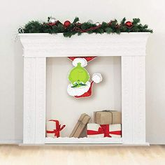 The Grinch is here to steal Christmas! This Glitter Grinch Santa Cutout is a fun addition to your mantle decorations. Flip him upside down and make it look like he's peeking in to see if the coast is clear. Grinch Party, Le Grinch, Grinch Christmas Party, Christmas Party Themes, Kids Christmas, Christmas Crafts, Christmas Carol, Christmas Birthday Party, Christmas Costumes