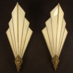 Art Deco theatre lamps. These 1920's leaded white opaque glass lamps feature a great Deco design with the original sockets and thumbscrew switches and wonderful patina.