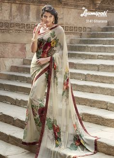 Vibrant floral prints with suble border all over this printed saree. Comes with printed diamond studded Lace border. Light weight. Ideal daily casual wear saree.
