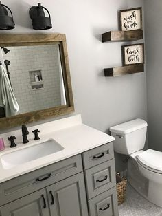 our powder room. sherwin williams honest blue paint in a