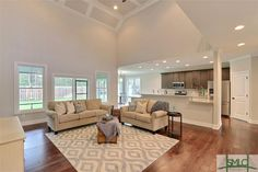 185 South Effingham Plantation Drive, Guyton, GA.  Gorgeous living room!  Heigh ceilings with details.  Wood floors.