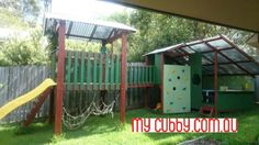 This cubby house set up has it all! A My Cubby duplex with a walk way to a fort. There is a rock wall and a slide and just so much fun to ne had! #MyCubby #CubbyHouse #Cubbies #Cubby #OutdoorPlay #Kids #AussieKids #HappyKids #Backyard #Fort #Christmas #Family #ChristmasLayby