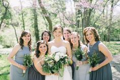 Mismatched bridesmaids in shades of gray are the perfect for the rustic feel of this real wedding.  Find the perfect mix-and-match grey bridesmaid dresses on Brideside.com