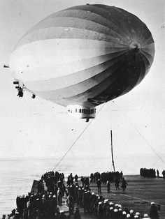 USS Los Angeles, ZR-3, lands onboard the USS Saratoga, CV-3, 28 January 1928. ZR-3, USS Los Angeles, was a zeppelin built in Germany for the United States Navy as part of a reparations payment. She was our longest-serving airship from 1924-1939. Her landing onboard the USS Saratoga on 28 January 1928 was a one-time event and as far as I know the only airship landing on a carrier. There possibly were others during the World War II years, but I haven't found any documented yet.