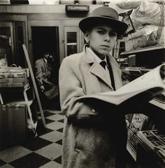 Boy Reading a Magazine, N.Y.C., 1956 by Diane Arbus