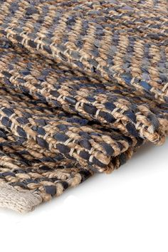 <ul> <li> Natural floor rug woven in jute and blue / jute and grey leather in a choice of two sizes to suit your living space.</li> </ul>  Products may vary slightly from one example to the next due to the handmade nature of the products.  Please note this item is classed as a large item and therefore, has special delivery requirements.