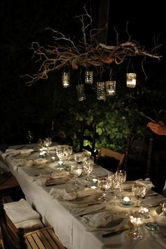 outdoor chandelier made from branches and hanging glass jars