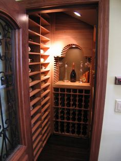 COOK ARCHITECTURAL Design Studio│A custom built wine-cellar, guarded by a wrought iron door in this San Francisco home. Architectural Design Studio, Wine Cellar Design, Wine Design, Home Wine Cellars, Wrought Iron Doors, Wine Storage, Storage Ideas, Under Stairs, Interior Design Living Room
