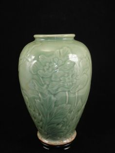 """Chinese celadon ovoid form vase with lotus & butterfly designs, drilled on base, ready for your use as a lamp base. Size: 12"""" Ht."""