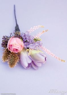 WedLuxe: purple and pink boutonniere