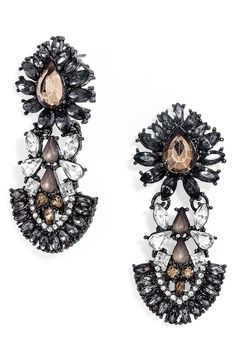 The dark sparkly crystals on these statement earrings add instant drama to any ensemble.
