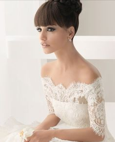 Lovely gown with understated elegance! Beautiful lace details on sleeves! Ross Clara??