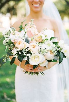 Loose Bouquet of White and Blush Roses, Tulips, Ranunculus, and Greenery. A blush-and-white bouquet comprised of garden roses, tulips, ranunculus, and greenery, created by The Southern Table.