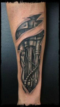 45 Awesome Biomechanical Tattoo Designs Biomechanical tattoos are awesome. There's no better way to phrase it. The incredible amount of detail put into these pieces makes them. Biomechanical Tattoo Arm, Biomech Tattoo, Piston Tattoo, Tattoos 3d, Badass Tattoos, Tattoos For Guys, Skin Tear Tattoo, Ripped Skin Tattoo, Forearm Sleeve Tattoos