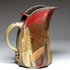 Slab built pitcher.  I can see throwing it, though, and using a cheese slicer :-)