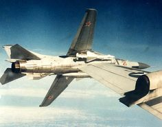 """A Soviet """"Flogger"""" peels away from a close encounter with a USN Orion Maritime Reconnaissance patrol aircraft during the Cold War. Air Force Aircraft, Fighter Aircraft, Fighter Jets, Military Humor, Military History, Old Brown Shoe, War Jet, F-14 Tomcat, Russian Air Force"""