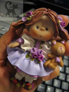 Handmade Collectible Doll (in my hand), via Flickr.
