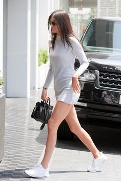 WHO: Kendall Jenner WORE: Grey mini dress and white sneakers WHERE: In Los Angeles