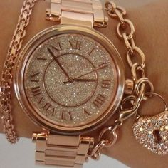 *NWOT* Michael Kors Watch This rose gold watch by Michael Kors is tasteful and elegant. Its' beautiful dial, comfortable bracelet and gorgeous crystals make this wonderful timepiece a must-have. This watch has never been worn see plastic still attached in 4th picture. Received as a gift but I've never been one for jewelry. 100% authentic. Box and care card included. The face diameter is 40mm (1.57 inches). Fold over with double push button release clasp. Water resistant at 30 meters / 100…