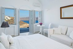 Relax in the luxurious and peaceful accommodation provided exclusively by the Canaves Oia villa