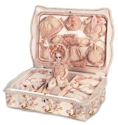 View Catalog Item - Theriault's Antique Doll Auctions - superb french silk presentation box with tiny bisque doll and trousseau, 6""