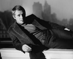 Steve McQueen goes smart casual in a corduroy jacket and turtleneck.