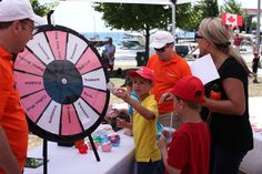 Oakville, Ontario photos - Fun Filled Day at Bronte Canada Day Celebration - Spinning the Prize Wheel at the Oakville.com booth