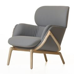 """Elysia chair by Luca Nichetto for De La Espada. """"The skeleton, traditionally hidden inside the upholstery, is deliberately exposed to showcase the craftsmanship and premium timber,"""" said Nichetto."""