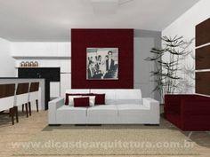 Sala com vermelho usado de forma equilibrada porém marcante. http://dicasdearquitetura.com.br/qual-cor-usar-na-parede-da-sala-com-madeira-branco-preto-e-vermelho/