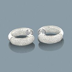 These 14K Inside Out Diamond Hoop Huggie Earrings showcase 0.92 ctw of sparkling pave-set round diamonds. Featuring a luxurious inside out design and a highly polished gold finish, these unisex small hoop diamond huggie earrings are available in 14K white, yellow and rose gold.