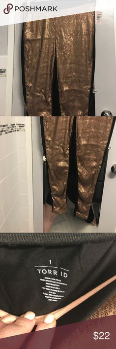 Torrid Rose Gold Sequin front leggings 1X Brand new with tags torrid leggings in a size 1X. These leggings have a rose gold sequin design in the front and regular black leggings in the back. They have Russian on the bottom near the ankle and the material is supersoft. torrid Pants Leggings