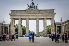 The royal couple are photographed at the Brandenburg Gate, one of Berlin's most famous landmarks.