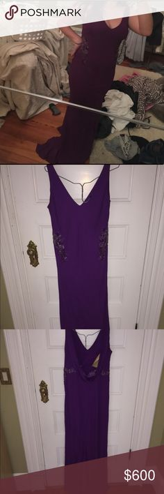 Purple prom dress Long purple dress, worn once. Hemmed to have smaller train. Size fourteen but runs small because a tighter dress Badgley Mischka Dresses Prom