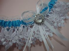 Lace garter Turquoise blue ribbon garter accented with rhinestone jewel by Hoalanebridal, Limited supply due to limited amount of rhinestones left. #weddings #brides #prom
