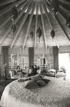 Johnny and June Cash...rocking the round bed...and a half-dozen swag lamps. Brilliant.